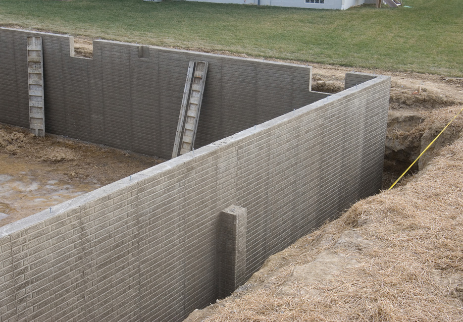 Afkar contracting est for Poured concrete basement walls